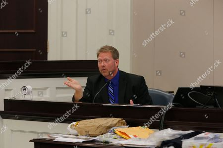 Stock Image of Thomas Owens Thomas Owens a forensic pathologist, testifies during the murder trial of former North Charleston police officer Michael Slager at the Charleston County court in Charleston, S.C