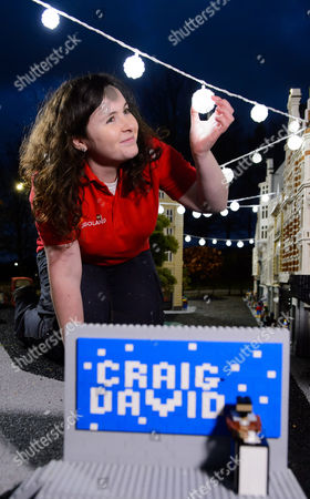 LEGOLAND® model maker Amanda Green puts the finishing touches to the LEGO recreation of the Oxford Street lights.