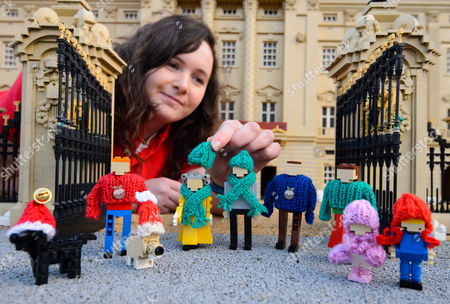 LEGOLAND® model maker Amanda Green adds a wooly hat to The Queen with the rest of her family wearing suitably festive knitwear.
