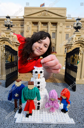 Stock Image of LEGOLAND® model maker Amanda Green puts the finishing touch to a snowy scene of the Duke and Duchess of Cambridge with Prince George and Princess Charlotte.