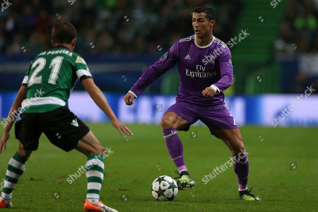 Cristiano Ronaldo, Joao Pereira Real Madrid's Cristiano Ronaldo fights for the ball against Sporting's Joao Pereira during a Champions League, Group F soccer match between Sporting CP and Real Madrid at the Alvalade stadium in Lisbon
