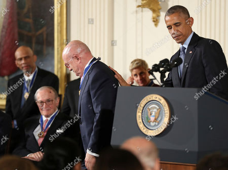 Barack Obama, Eduardo Padron President Barack Obama taps Miami Dade College President Eduardo Padron on the back after being presented with a Presidential Medal of Freedom during a ceremony in the East Room of the White House, in Washington