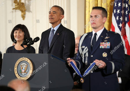 Barack Obama, Maya Lin President Barack Obama presents the Presidential Medal of Freedom to Vietnam Veterans Memorial Architect Maya Lin during a ceremony in the East Room of the White House, in Washington. Obama is recognizing 21 Americans with the nation's highest civilian award, including giants of the entertainment industry, sports legends, activists and innovators