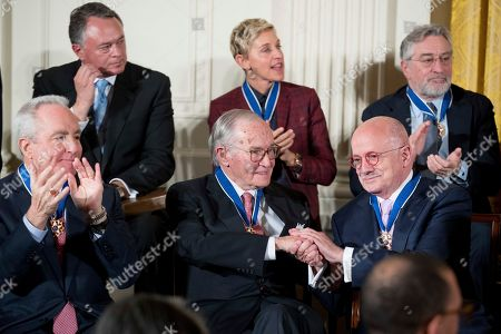 Stock Picture of Barack Obama, Eduardo Padron, Ellen DeGeneres, Robert De Niro, Lorne Michaels Miami Dade College President Eduardo Padron, bottom right, shakes hands with attorney and former Chair of the Federal Communications Commission Newt Minow, bottom center, after receiving the Presidential Medal of Freedom during a ceremony in the East Room of the White House, in Washington. Obama is recognizing 21 Americans with the nation's highest civilian award, including giants of the entertainment industry, sports legends, activists and innovators. Also pictured is actress, comedian, and talk show host Ellen DeGeneres, top center, actor Robert De Niro, top right, and Saturday Night Live producer and screenwriter Lorne Michaels, bottom left