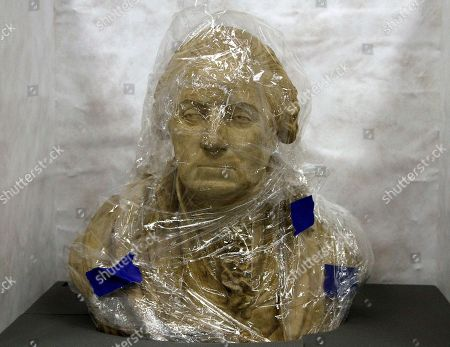 """Stock Image of A terracotta and plaster bust of George Washington, made by William Rush in 1817, is wrapped in plastic in a shipping container at the Museum of the American Revolution in Philadelphia. History buffs will be able to peer into the eyes of a """"most excellent likeness"""" of George Washington and get an actual whiff of the Revolutionary War when Philadelphia's Museum of the American Revolution opens next year. The collection of art, printed works, immersive exhibits and objects from the Revolutionary Era opens April 19"""