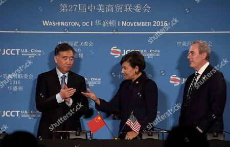 Stock Image of Penny Pritzker, Wany Yang, Michael Froman Commerce Secretary Penny Pritzker, center, talks with Chinese Vice Premier of the State Council Wang Yang, left, with U.S. Trade Representative Ambassador Michael Froman at right, following a signing ceremony at the 27th session of the U.S.-China Joint Commission on Commerce and Trade in Washington