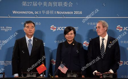 Penny Pritzker, Wany Yang, Michael Froman Commerce Secretary Penny Pritzker, center, stands with Chinese Vice Premier of the State Council Wang Yang, left, and U.S. Trade Representative Ambassador Michael Froman, before the start of a signing ceremony at the 27th session of the U.S.-China Joint Commission on Commerce and Trade in Washington