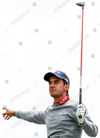 Matteo Manassero (ITA) points out after playing a wayward drive during the round 1