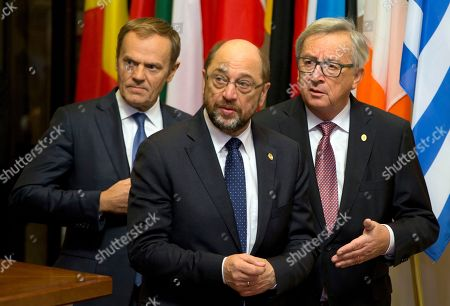 European Council President Donald Tusk, left, walks with European Parliament President Martin Schultz, center, and European Commission President Jean-Claude Juncker prior to an EU-Ukraine summit at the European Council building in Brussels on