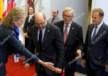 European Council President Donald Tusk, right, European Parliament President Martin Schultz, second left, and European Commission President Jean-Claude Juncker, second right, are directed to their places during arrivals for an EU-Ukraine summit at the European Council building in Brussels on