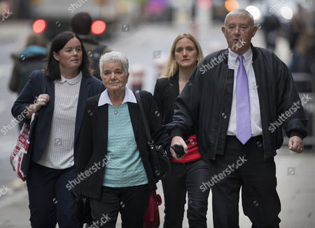 Jo Cox's parents Gordon Leadbeater (R) and Jean Leadbeater, walk with Jo's sister Kim Leadbeater (2L) and her partner Claire