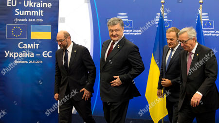 European Parliament President Martin Schultz, left, walks with, from second left, Ukrainian President Petro Poroshenko, European Council President Donald Tusk and European Commission President Jean-Claude Juncker during arrivals for an EU-Ukraine summit at the European Council building in Brussels on