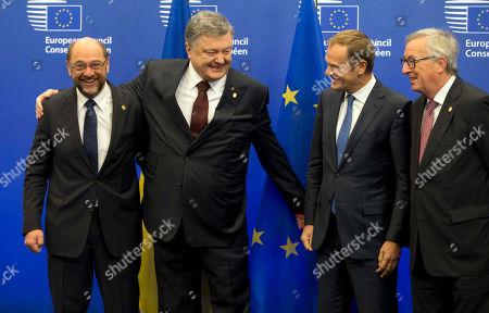 European Parliament President Martin Schultz, left, welcomes Ukrainian President Petro Poroshenko, second left, during an EU-Ukraine summit at the European Council building in Brussels on . At right is European Commission President Jean-Claude Juncker and second right is European Council President Donald Tusk