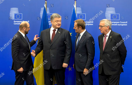Ukrainian President Petro Poroshenko, second left, speaks with European Council President Donald Tusk, second right, and European Commission President Jean-Claude Juncker, right, during arrivals for an EU-Ukraine summit at the European Council building in Brussels on . At left is European Parliament President Martin Schultz