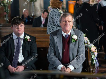 Alex, as played by Liam Bairstow, Chesney Battersby, as played by Sam Aston, Sinead Tinker, as played by Katie McGlynn, Faye Windass, as played by Ellie Leach, Sally Metcalfe, as played by Sally Dynevor, Tim Metcalfe, as played by Joe Duttine, Rita Sullivan, as played by Barbara Know, Norris Cole, as played by Malcolm Hebden, Mary Taylor, as played by Patti Clare, Tyrone Dobbs, as played by Alan Halsall, Brian, as played by Pete Gunn, Audrey Roberts, as played by Sue Nicholls, Bethany Platt, as played by Lucy Fallon, and a nervous Roy Cropper, as played by David Neilson, gather in the church awaiting Cathy's arrival (Episode 9054 - Mon 12 Dec 2016)