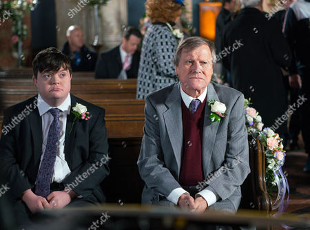 Ep 9054 Monday 12 December 2016 - 1st Ep Alex, as played by Liam Bairstow, Chesney Battersby, as played by Sam Aston, Sinead Tinker, as played by Katie McGlynn, Faye Windass, as played by Ellie Leach, Sally Metcalfe, as played by Sally Dynevor, Tim Metcalfe, as played by Joe Duttine, Rita Sullivan, as played by Barbara Knox, Norris Cole, as playd by Malcolm Hebden, Mary Taylor, as played by Patti Clare, Tyrone Dobbs, as played by Alan Halsall, Brian, as played by Pete Gunn, Audrey Roberts, as played by Sue Nicholls, Bethany Platt, as played by Lucy Fallon, and a nervous Roy Cropper, as played by David Neilson, gather in the church awaiting Cathy's arrival