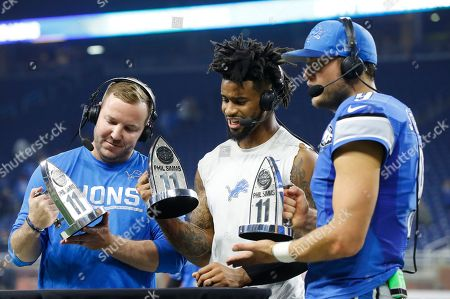 Matthew Stafford, Darius Slay, Matt Prater Detroit Lions kicker Matt Prater, left, cornerback Darius Slay, center, and quarterback Matthew Stafford are presented the Phil Simms All-Iron trophies after their 16-13 win over the Minnesota Vikings, in Detroit