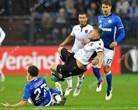 Schalke's Sascha Riether and Nice's Remi Walter, right, challenge for the ball during the Europa League group I soccer match between FC Schalke 04 and OGC Nice in Gelsenkirchen, Germany