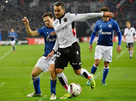 Nice's Anastasios Donis and Schalke's Sascha Riether, left, challenge for the ball during the Europa League group I soccer match between FC Schalke 04 and OGC Nice in Gelsenkirchen, Germany