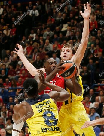 Olimpia's Rakim Sanders, top left, goes for the basket as Fenerbahce's Jan Vesely, top right, and Ekpe Udoh trie to stop him during the Euro League basketball match between Olimpia Milan and Fenerbahce Istanbul in Milan, Italy