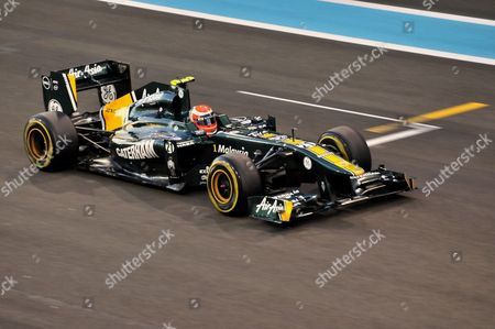 Formula One racing cars of Jarno Trulli, Italy, start number 21, of the Team Lotus-Renault on the Yas Marina Circuit race track on Yas Island during the Grand Prix 2011, Abu Dhabi, United Arab Emirates, Orient, Arabia