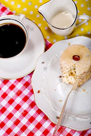 Piece of cake roll and a cup of coffee