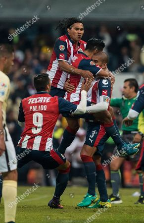 Carlos Salcido Chivas' Carlos Salcido, right, celebrates with his teammates after scoring against America during a Mexico soccer league match in Mexico City