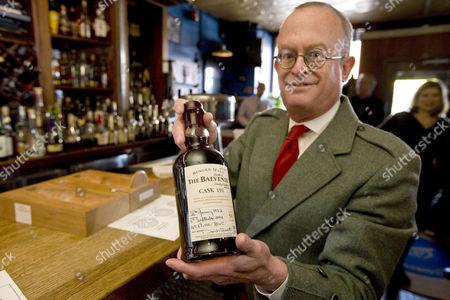 John Maxwell with his fifty-year-old Balvenie single malt scotch whisky