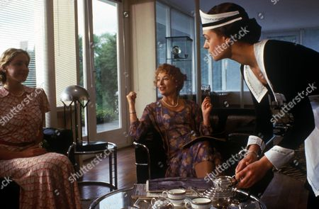 'Poirot'   - 'The Murder of Roger Ackroyd' - Vivian Heilborn as Mrs Ackroyd and Flora Ackroyd, played by Flora Montgomery, take tea, served by Ursula Bourne, played by Daisy Beaumont