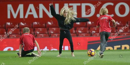 Hazel Moder, Phinnaeus Moder And Henry Daniel Moder. Julia Roberts Children Play On The Old Trafford Pitch After The Match