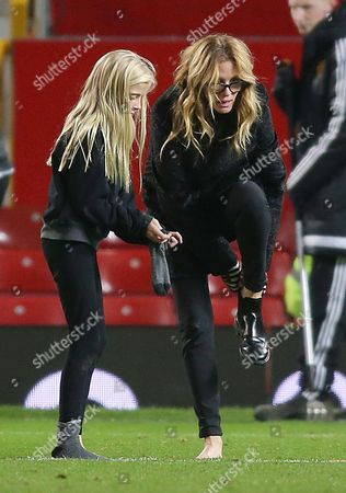 Stock Photo of Julia Roberts changing her boots on the pitch after the match with daughter Hazel Moder
