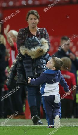 Klay ROONEY ON THE PITCH AFTER THE MATCH WITH MOTHER COLEEN ROONEY