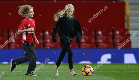 Stock Picture of HENRY MODER AND HAZEL MODER   [JULIA ROBERTS CHILDREN] ON MANCHESTER UNITED PITCH AFTER THE MATCH PLAYS FOOTY