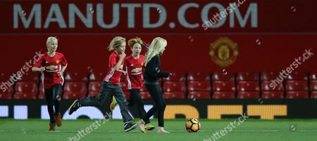 Stock Picture of PHINNAEUS MODER, HENRY AND HAZEL [JULIA ROBERTS CHILDREN] ON MANCHESTER UNITED PITCH AFTER THE MATCH PLAYS FOOTY