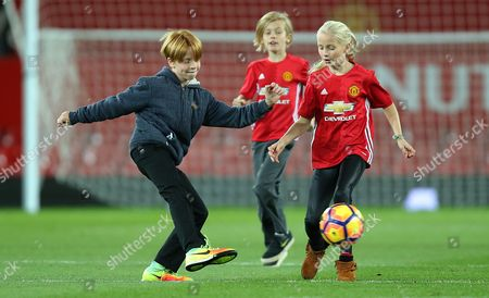 Stock Image of PHINNAEUS MODER [JULIA ROBERTS CHILD] ON MANCHESTER UNITED PITCH AFTER THE MATCH PLAYS FOOTY WITH BROTHER HENRY AND FRIEND GEORGIA