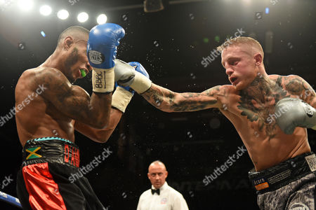 Stock Photo of Lee Markham (grey/black shorts) defeats Andrew Robinson to win the English Middleweight Title during a Boxing Show at the Brentwood Centre on 25th November 2016