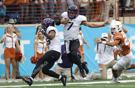 Kenny Hill, John Bonney TCU quarterback Kenny Hill (7) leaps around Texas defender John Bonney (24) as he runs for a 41-yard touchdown during the second half of an NCAA college football game, in Austin, Texas