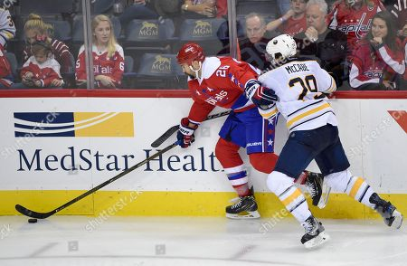 Jake McCabe, Daniel Winnik Buffalo Sabres defenseman Jake McCabe (29) battles for the puck against Washington Capitals left wing Daniel Winnik (26) during the third period of an NHL hockey game, in Washington. The Capitals won 3-1