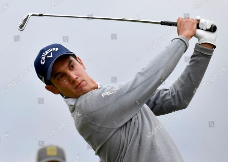 Italy's Matteo Manassero hits off the sixth tee during his match at the World Cup of Golf at Kingston Heath in Melbourne, Australia