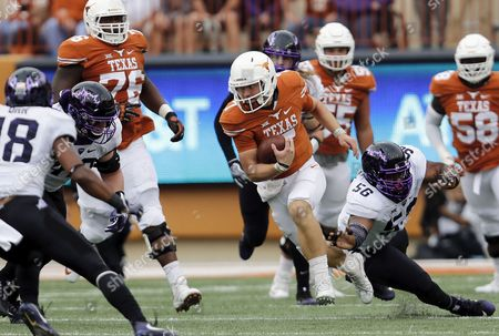 Texas Longhorns quarterback Shane Buechele (7) scrambles past TCU Horned Frogs defensive tackle Chris Bradley (56) during the NCAA football game between the TCU Horned Frogs and the Texas Longhorns at Darrell K Royal-Texas Memorial Stadium in Austin, TX. The Horned Frogs defeated the Longhorns 31-9; Tim Warner/CSM