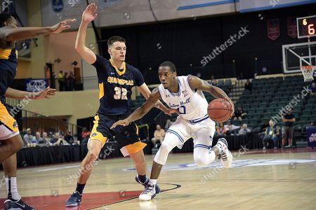 Seton Hall guard Khadeen Carrington (0) drives against Quinnipiac guard Peter Kiss (32) during the first half of an NCAA college basketball game at the AdvoCare Invitational tournament in Lake Buena Vista, Fla