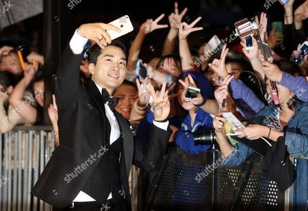 Stock Picture of Song Seung Heon South Korean actor Song Seung Heon takes a selfie photo with fans on the red carpet at the 53rd Golden Horse Awards in Taipei, Taiwan, . Song is a guest at this year's Golden Horse Awards, one of the Chinese-language film industry's biggest annual events