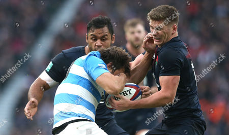 Owen Farrell of England (R) steals the ball from Juan Martin Hernandez of Argentina which sets up Billy Vunipola of England (L)  to break and being awarded a penalty try during England v Argentina, Old Mutual Wealth Series, Twickenham Stadium, London on 26th November 2016