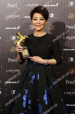 """Elaine Jin Taiwanese actress Elaine Jin holds her award for Best Supporting Actress at the 53rd Golden Horse Awards in Taipei, Taiwan, . Jin won for the film """"Mad World"""" at this year's Golden Horse Awards -the Chinese-language film industry's biggest annual events"""