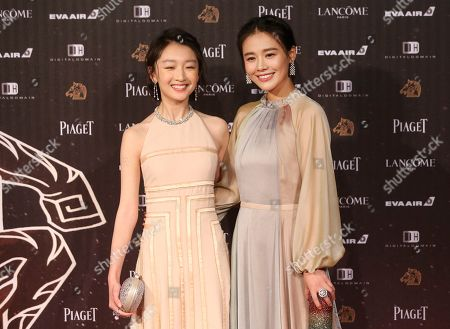 "Zhou Dongyu, left, and Ma Sichun arrive at the 53rd Golden Horse Awards in Taipei, Taiwan,. They are nominated as Best Leading Actress for the film ""Soul Mate"" at this year's Golden Horse Awards -one of the Chinese-language film industry's biggest annual events"