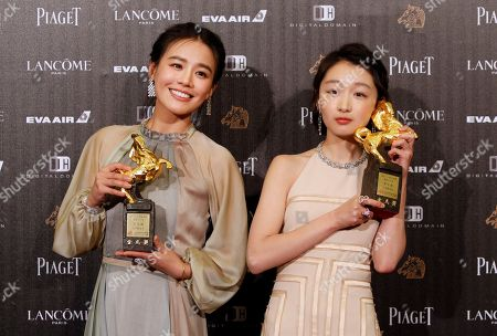 "Zhou Dongyu, right, and Ma Sichun hold their award for Best Leadting Actress at the 53rd Golden Horse Awards in Taipei, Taiwan,. They won for the film ""Soul Mate"" at this year's Golden Horse Awards -the Chinese-language film industry's biggest annual events"