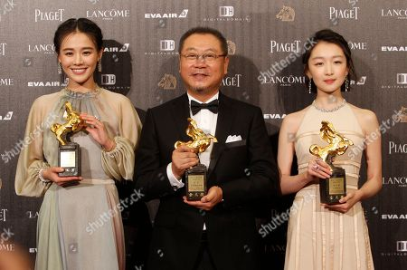 "Zhou Dongyu, Ma Sichun, Fan Wei Correction : Chinese actress Zhou Dongyu, from right, actor Fan Wei and actress Ma Sichun hold their award for Best Leadting Actress and Actor at the 53rd Golden Horse Awards in Taipei, Taiwan,. They won for the film ""Soul Mate"" and ""Mr. No Problem"" at this year's Golden Horse Awards -the Chinese-language film industry's biggest annual events"