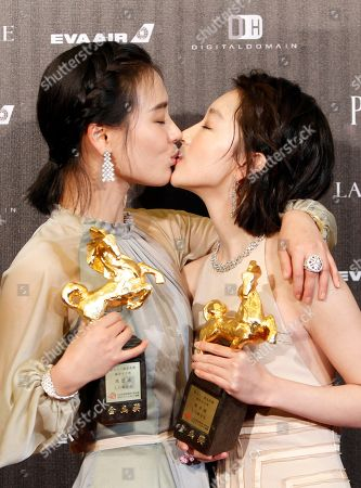 "Zhou Dongyu and Ma Sichun hold their awards for Best Leading Actress at the 53rd Golden Horse Awards in Taipei, Taiwan,. They won for the film ""Soul Mate"" at this year's Golden Horse Awards -the Chinese-language film industry's biggest annual events"