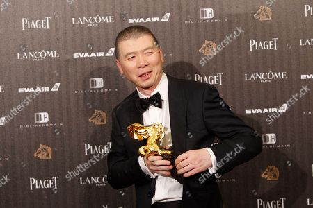 """Feng Xiaogang Chinese director Feng Xiaogang holds his award for Best Director at the 53rd Golden Horse Awards in Taipei, Taiwan, . Feng won for the film """"I Am Not Madame Bovary"""" at this year's Golden Horse Awards -the Chinese-language film industry's biggest annual events"""