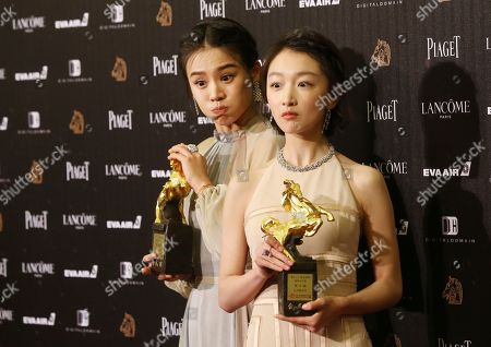 "Zhou Dongyu, right, and Ma Sichun hold their award for Best Leading Actress at the 53rd Golden Horse Awards in Taipei, Taiwan,. They won for the film ""Soul Mate"" at this year's Golden Horse Awards -the Chinese-language film industry's biggest annual events"